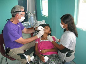 Dr. David Nichols (Tyler Rotary) providing dental care in Southern Belize.