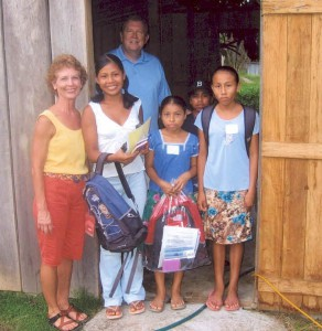 Jo Dobbs (Sunrise Rotary) and Barry Jones (Sunrise Rotary) distributing school supplies to the Mayan Indians in Southern Belize.